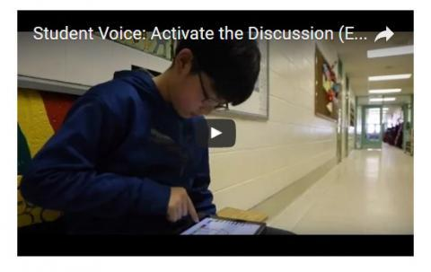 student reading with overlay of video play button