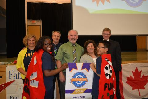 Students, teacher and Ophea CEO posing for picture with Healthy Schools Certificate